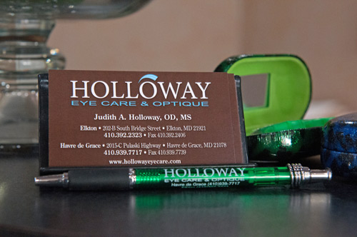 Holloway Eyecare & Optique business card